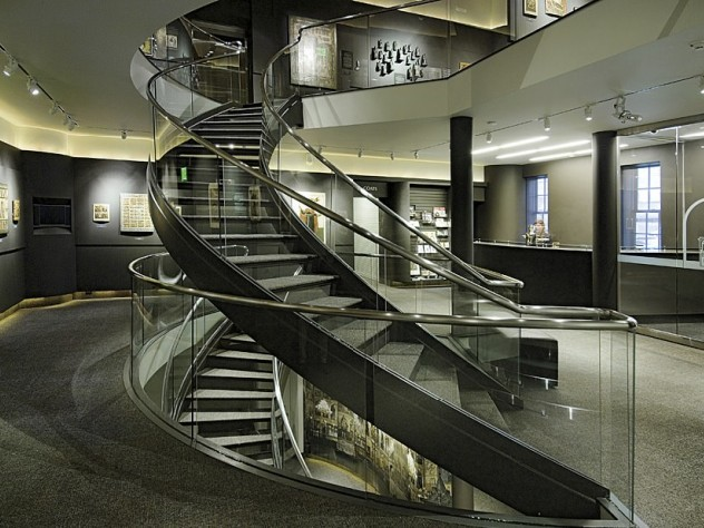 An elegant interior spiral staircase leads to exhibits.