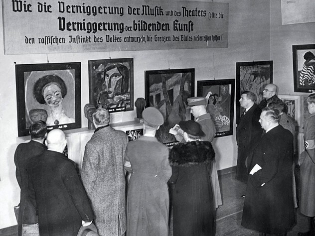 Harvard eventually acquired a Van Gogh self-portrait and the Emil Nolde painting The Mulatto, seen at far left in this photograph of visitors to the Exhibit of Degenerate Art.