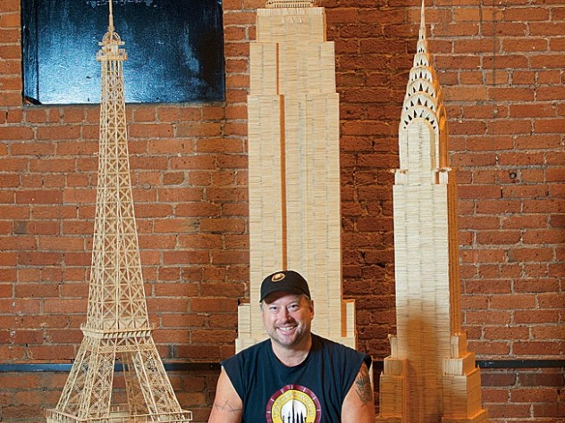"Towering over Munro are his ""toothpicked"" versions of the Eiffel Tower and the Empire State and Chrysler buildings."