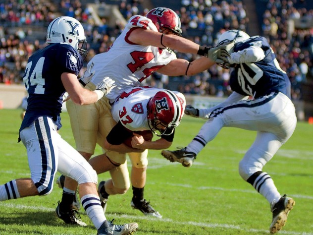 The Murphy effect: Having eschewed an easy field goal, Harvard placekicker David Mothander (37) carried out the fake called by his coach and crashed over the goal line for a momentum-building touchdown against Yale in 2011.