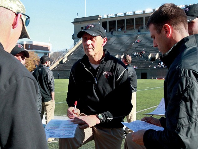 The year before, at the Stadium, Murphy consulted with his assistants before a 38-30 victory over Bagnoli and his Quakers.