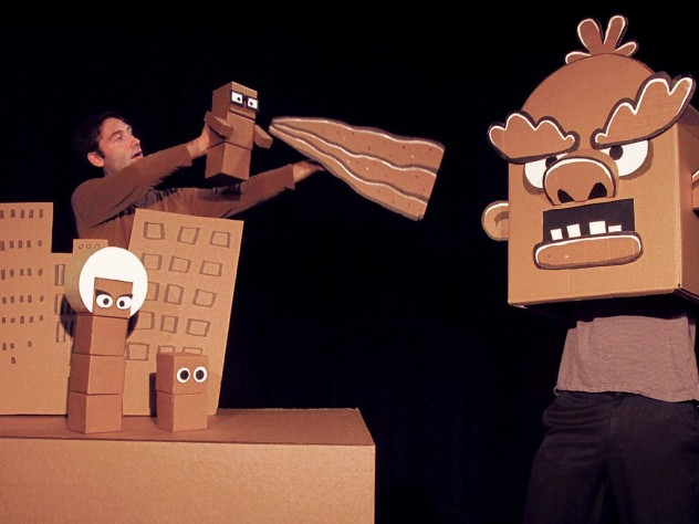 Brad Shur performing in his new show, Cardboard Explosion!