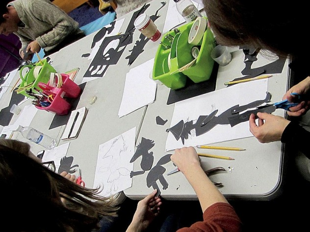 Students engaged in the art of shadow puppetry