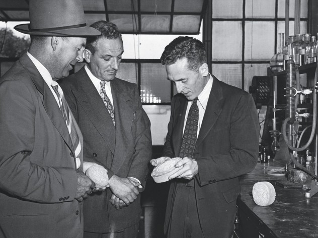 Walker, with visitors, in his lab in 1948