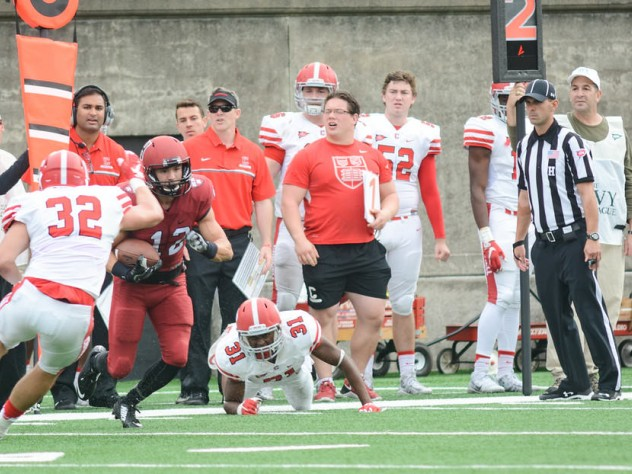 On one of his four receptions, Harvard's Joe Foster proved elusive for Big Red defenders DJ Woullard (31) and Daniel Crocher.