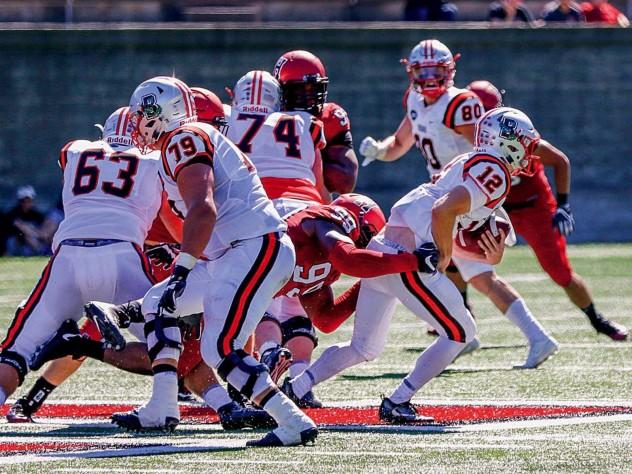 Junior defensive end DJ Bailey (99) registered one of five Harvard sacks against Brown quarterback Nick Duncan.