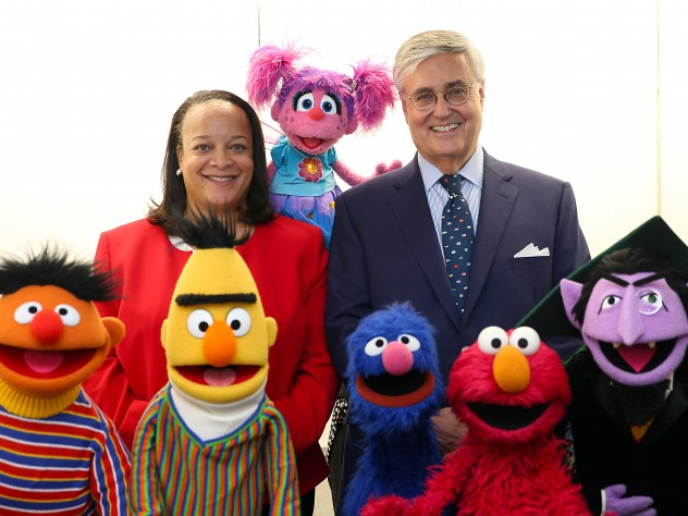 Harvard education dean Bridget Terry Long and Sesame Workshop CEO Jeffrey Dunn with a group of Muppets