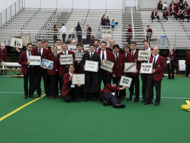 Band members display the signal cards for Harvard fight songs.