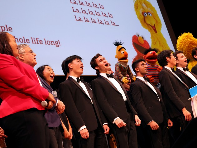 The Harvard Krokodiloes sing with Muppets and Harvard and Sesame Street leaders.