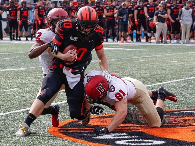 Isaiah Wingfield and Brogan McPartland of Harvard tackle Princeton quarterback.