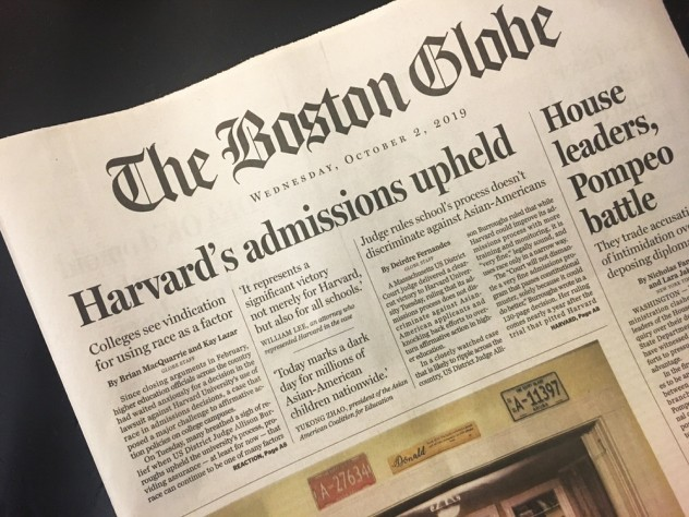 "The Boston Globe's front page on October 2, 2019, with the headline ""Harvard's admissions upheld"""