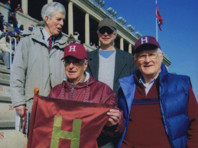 Paul Lee (left) holds the Little Red Flag replica in 2012. Also shown (clockwise from top left) are Spencer Ervin, Jeffrey Lee, and Stephen Goodhue.