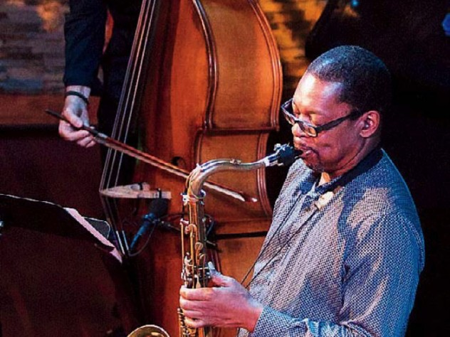 Ravi Coltrane viewed from the top, playing a saxophone