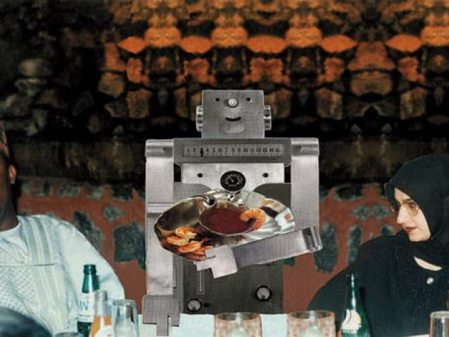 Guests at an elegant Nigerian dinner party are served by a boxy metallic robot.