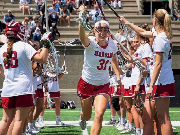 The Harvard women's lacrosse team takes the field.