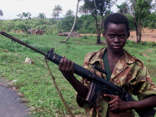 Photograph of a child soldier from Sierra Leone holding a self-loading rifle