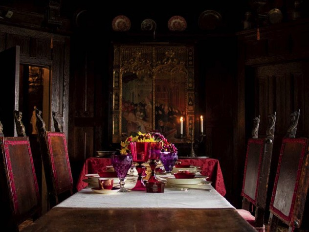 A Gothic-style dining room, with the table set for a formal dinner