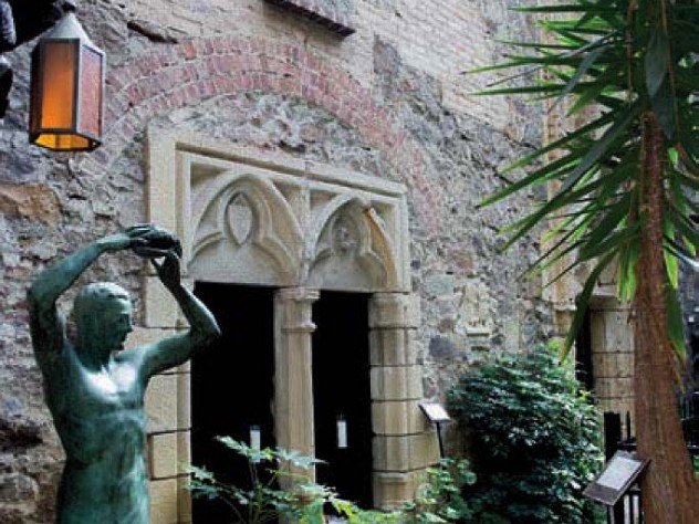 Castle courtyard with statue and stone work