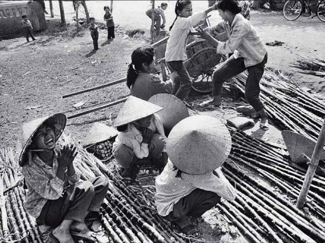 "Black and white photo of street vendors, titled ""Sugarcane Mongers"""