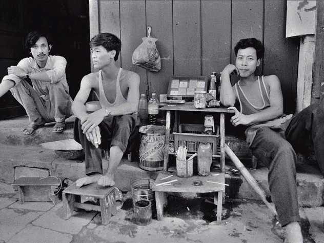 """Black and white photo, titled """"Three Tobacconists"""""""