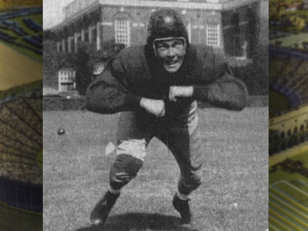 Football player Chubb Peabody, in pads and helmet, charges forward.