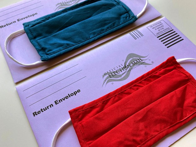 photograph of two election mail envelopes with face masks