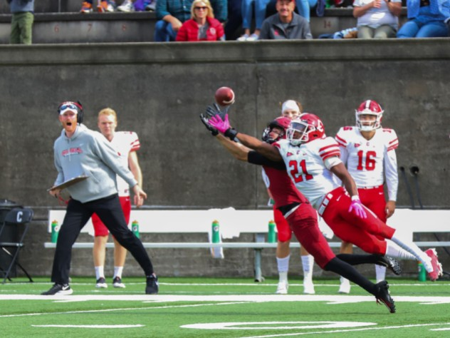 Tightly defended by Cornell's Kenan Clarke, Harvard senior wideout James Batch just fails to make the catch.