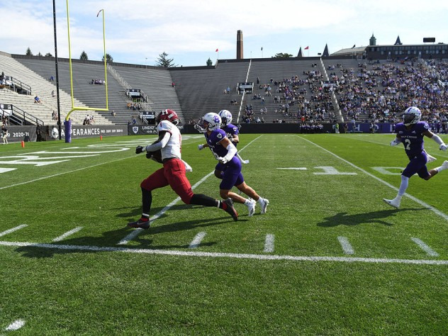 Kym Wimberly runs down the sideline with ball in hand.