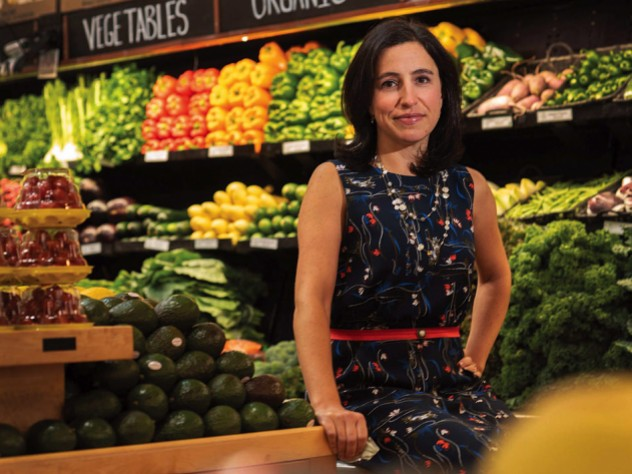 Emily Broad Leib in front of produce