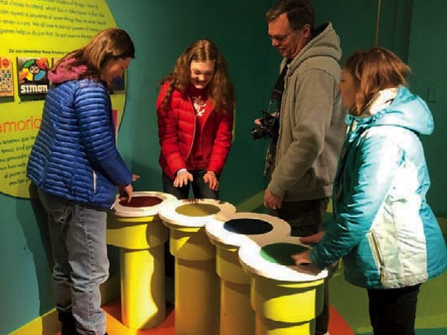 Family and friends enjoying interactive games at the Springfield Museums