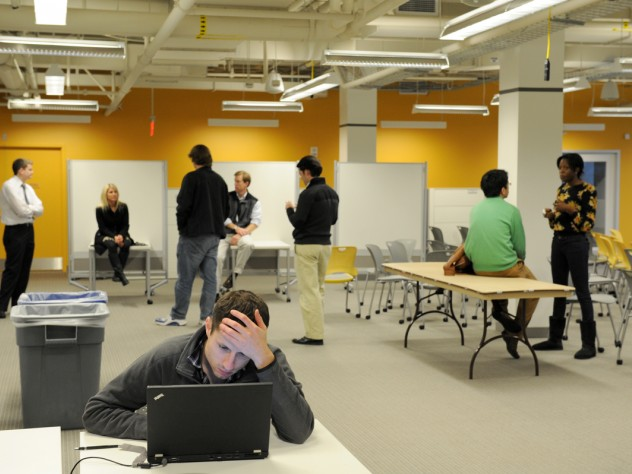 Users arrange themselves in the lab's flexible workspaces.