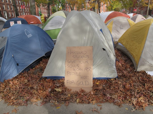 A protester's sign outside of a tent.