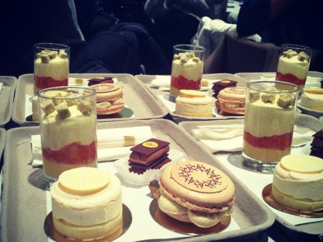 The four desserts—a lemon cake, a macaron, yuzu wasabi gelée with fresh grapefruit confit and mascarpone cream, and a milk-chocolate-and-hazelnut treat