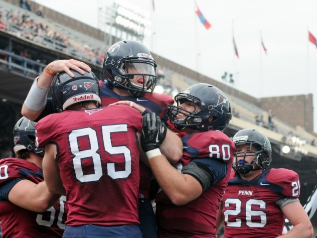 Penn players celebrate after a second-period touchdown reception by tight end Ryan O'Malley (85). Tailback Lyle Marsh (26) was the game's leading ground-gainer, with 130 yards rushing.