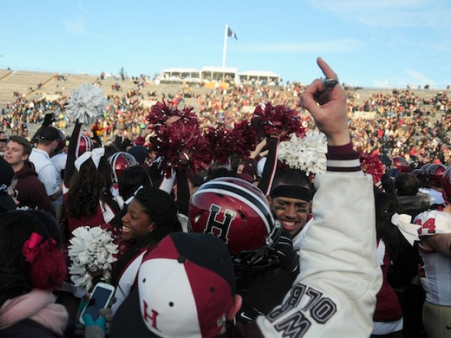 Harvard partisans stormed the field at Yale Bowl to celebrate the Crimson's seventh consecutive victory over the Blue. Thousands of discouraged Yale followers had left the Bowl at halftime.