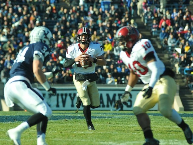 Quarterback Conner Hempel directed the Crimson offense, passing for 209 yards and two touchdowns and gaining 57 yards on 10 carries. The Yale defender is safety Robert Ries; blocking for Hempel is running back Seitu Smith III.