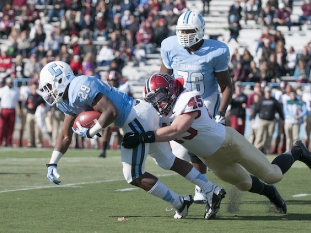 Strong defensive play held Columbia's ground game to a net 49 yards rushing. Above, senior linebacker Matt Martindale (45) hauls down tailback Alan Watson. Martindale finished the game with five tackles and a quarterback sack.