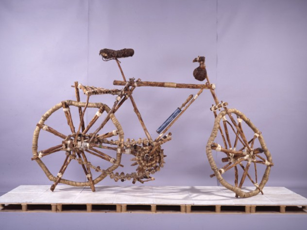 <i>Bicicleta rural/Rural Bicycle</i>, an eight-foot-tall wood and rope sculpture by Mozambique artist Titos Mabota, towers over the final room of the Cooper Gallery exhibit.