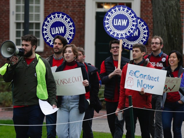 Union protesters march at Harvard University in Cambridge, Mass., Wednesday, May 1, 2019.