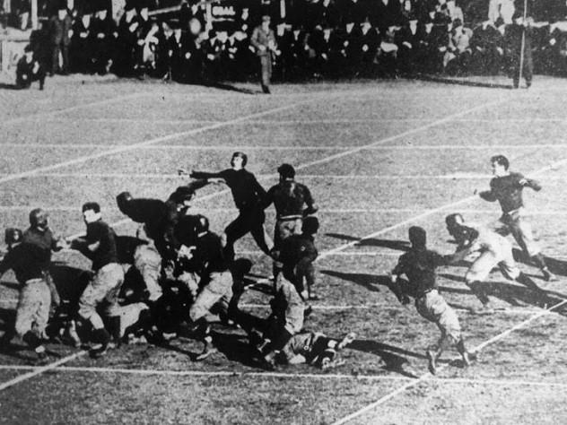 A ball flies through the air off the foot of Vic Kennard.