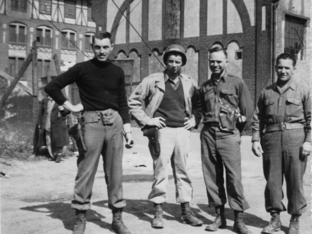Monuments Men George Stout (at left) and Walter Hancock and Steven Kovalyak flank a fellow soldier in a May 1945 photograph.
