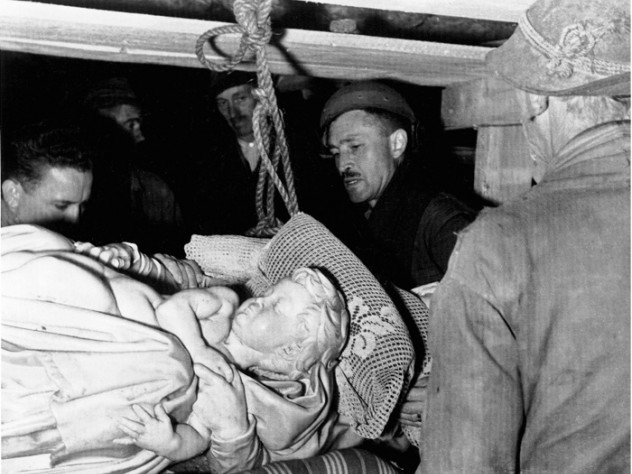 Stout (center) and Steven Kovalyak (far left) supervise the removal of Michelangelo's <em>Bruges Madonna</em> from the salt mine at Altaussee, Austria.