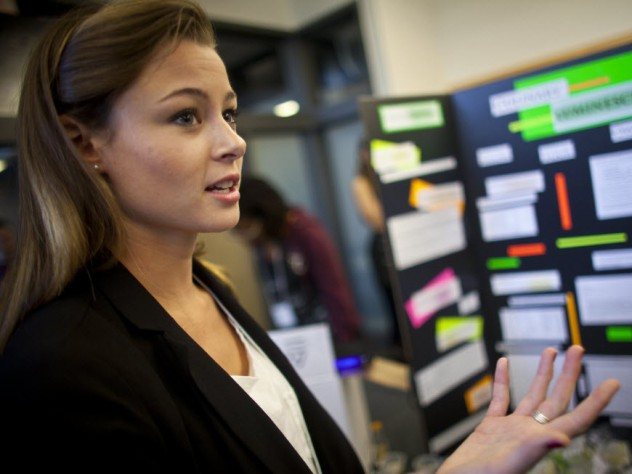 Katherine Caputo '12 explains her project at the fair where students in the course presented their final projects.