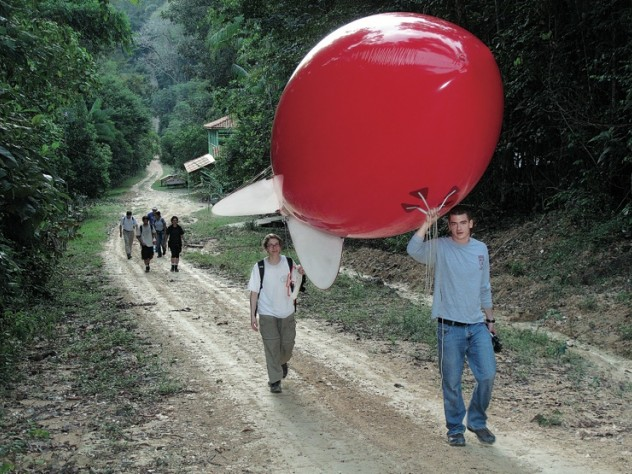 Newell and Horowitz walk the weather balloon to the launch site