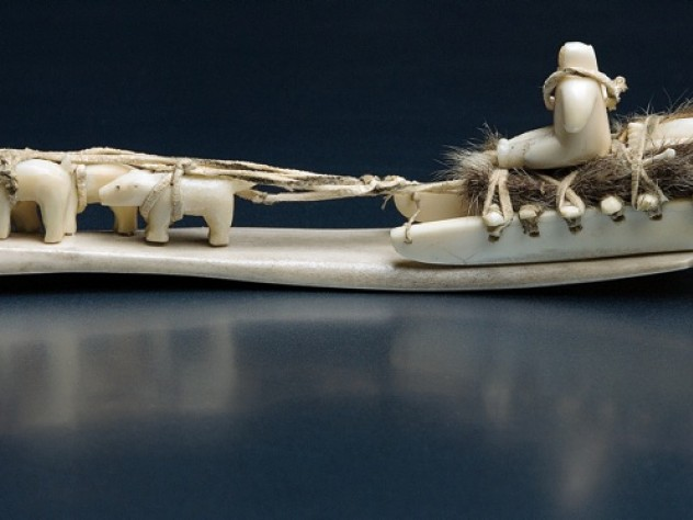 The Inuit artist who created this dogsled from carved ivory, leather, and sealskin is unknown.
