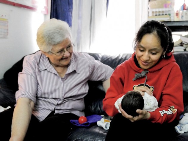 In East Harlem, Susana Saldivar and her son Xavier receive a visit from Sister Suzanne Deliee, a nurse with Little Sisters of the Assumption Family Health Service.