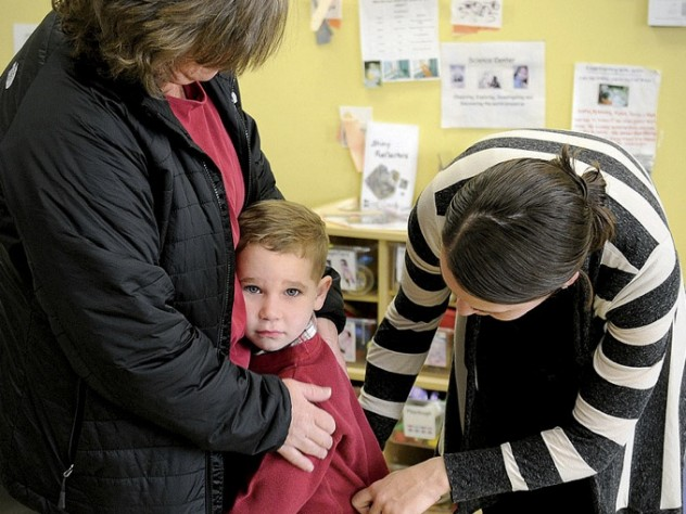 In Dorchester, Liam Denver has a hard time saying goodbye to his mother, Kim, as teacher Carolyn Christopher offers comfort.