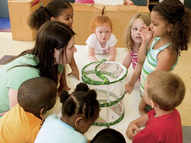 In Dorchester, at the Boys & Girls Club, kindergarten-age children play with teacher Melissa Ryan.