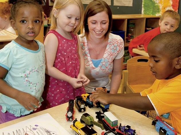 Teacher Meghan McDonough plays with preschoolers.