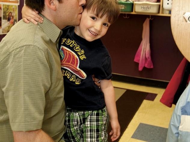 At the Boys & Girls Club, Joshua Coleman drops off his son, Noah.